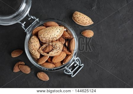 Almonds And  Hazelnuts In A Glass Jar