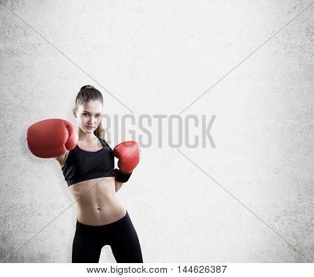 Woman Boxer Near Concrete Wall