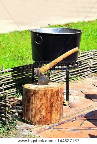 Axe-cleaver wooden block for cutting firewood and boiler for cooking