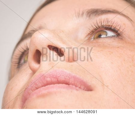 close up shot of woman face focus on nose