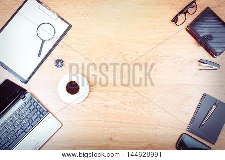 Business desktop objects isolated on background: laptop tablet smartphone calculator usb stick paperwork and other items top view