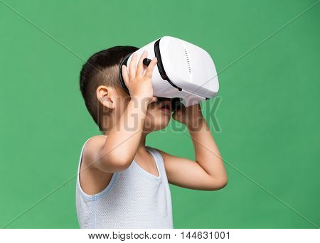 Little kid watching though virtual reality device
