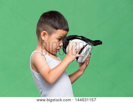 Little boy uisng VR device
