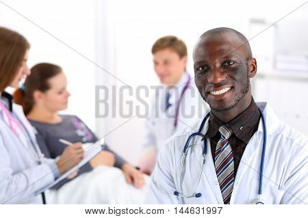 Black Smiling Male Doctor Look In Camera