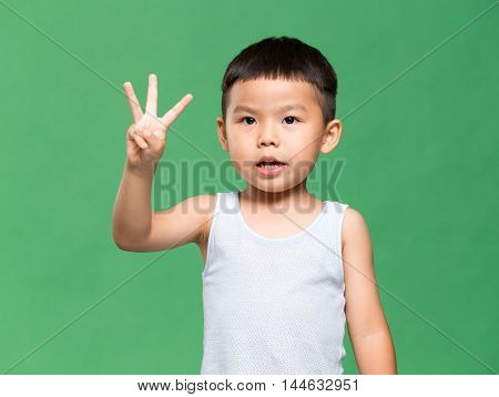 Little boy showing three finger