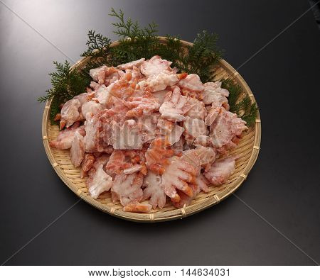 Boyle red snow crab shoulder meat half-cut on bamboo tray in grey background