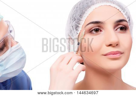 Young woman preparing for plastic surgery isolated on white