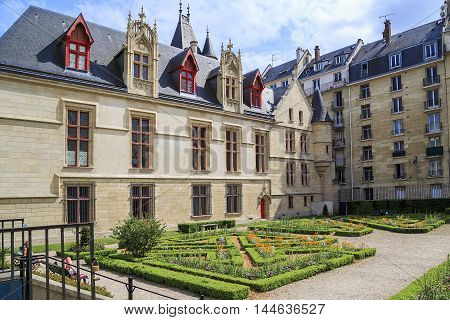 PARIS, FRANCE - MAY 13, 2015: Hotel de Sens is a small urban palace with architectural elements of a castle or fortress which combines Gothic and Renaissance styles.