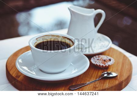 White Cup With Coffee Standing On The Table In A Cafe