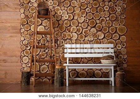 White bench and steps on round timber background
