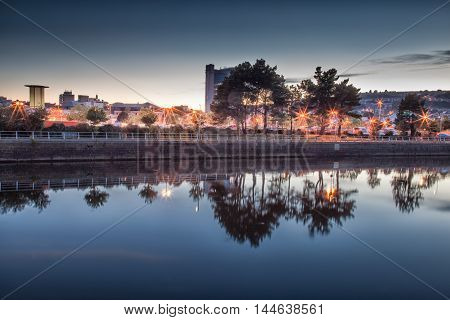 Evening reflections on the River Tawe in Swansea, South Wales