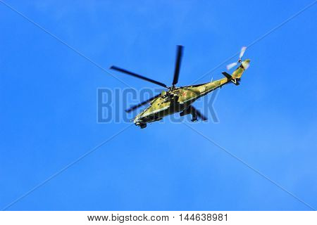 Syzran Russia - August 24 2016. military helicopter Russian MI-24 fire support with full arms performs the task of protection of a given area