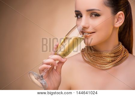 Young woman with champagne glass