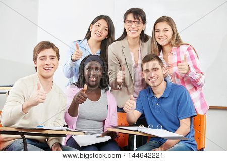 Successful group of students with their thumbs up