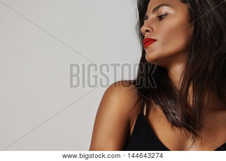 Spanish Woman With Bright Red Lips Watching Aside