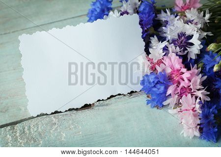 Card with bluettes on wooden background