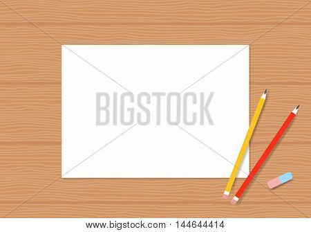 Blank white paper with pencil on wood table. Album pages with pencils for drawing on a wooden table