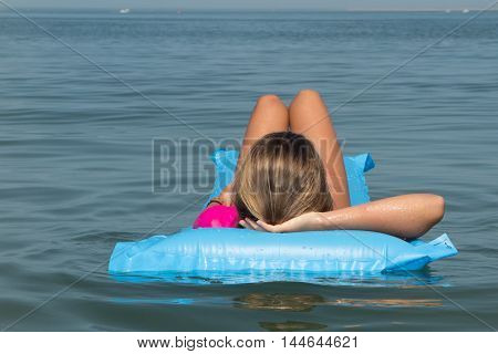 Beach Vacation Girl Relaxing In Blue Plastic Pool Air Bed