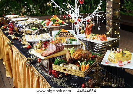 Delightful Christmas buffet with roasted chicken beef pork seafood lobsters in restaurant