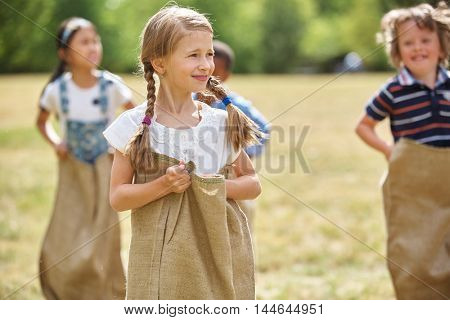 Girl with braided hair at a sack competiton