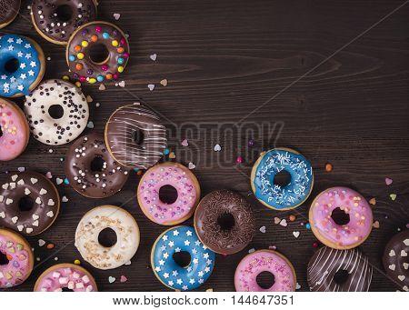 Donuts on a dark wooden background