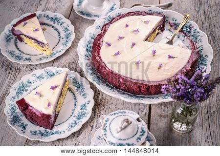 Blueberry cheesecake decorate with flower on wooden