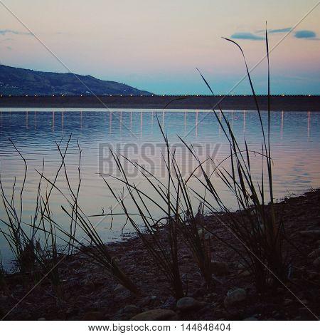 Lake Nicoletti coast near Enna city. Aged photo. View of Lake Nicoletti with sunset. Near the Enna city. Sicily Italy.