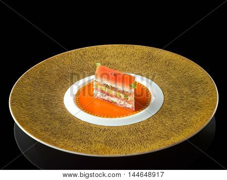 King crab and tomato mille feuille with a coulis verjute