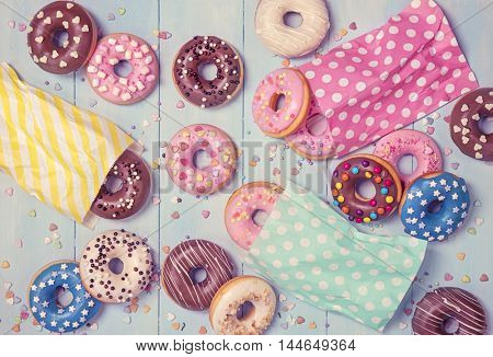 Donuts on a pastel blue wooden background