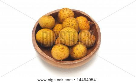 Longan in wood bowl macro photo select focus at longan center on white wood