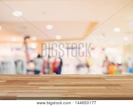 Wood Table And Shopping Mall Blurred Background With Space For Product.