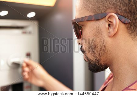 Profile Headshot Of Young Handsome Serious And Concentrated African Man In Trendy Sunglasses Trying