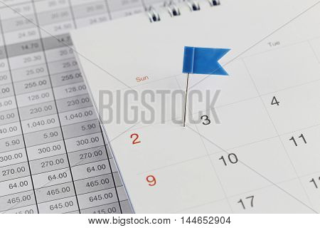 Blue Pins to Wildcats on the calendar beside the number of two in business concept time and date.