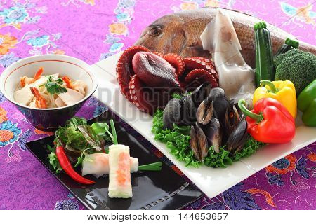 Vietnamese spring vegetables rolls with sea bream blue mussel squid octopus snapper shrimp chili and herbs