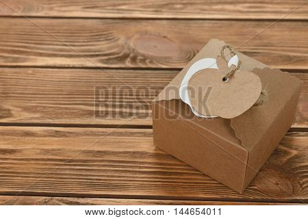 Kraft box with tag on a brown background