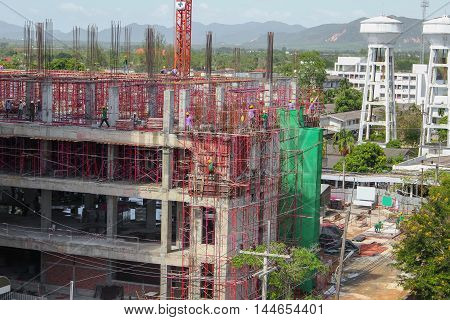 Construction and renovation of tall buildings building under  in scaffolding in Thailand.