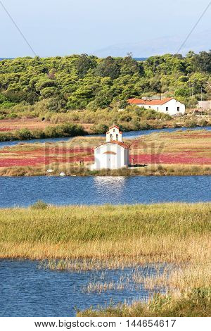 Church of St. Peter on the shore of Lake Procopius and protected forest of Strofilia. Peloponnese Greece