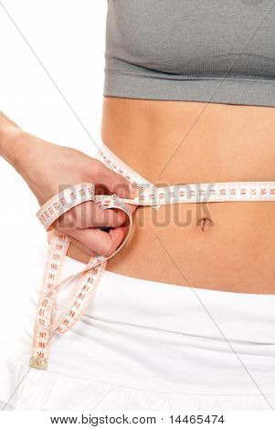 Athletic Fit Slim Woman Measuring Her Waist