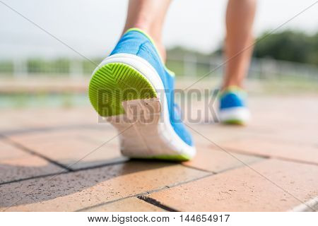 Woman running in a city