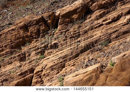 Diagonal mountain layers structure, brown background pattern