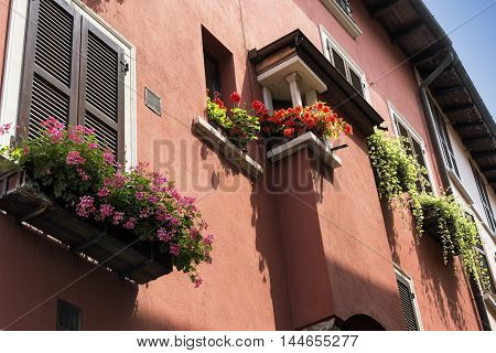 Windows and flowers in Porto Ceresio (Varese Lombardy Italy) along the Lake of Lugano (Ceresio)