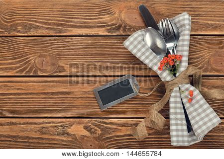 Cutlery and holiday decorations on brown background