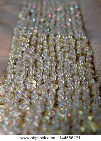 Golden fabric which is embroidered with beads , closeup