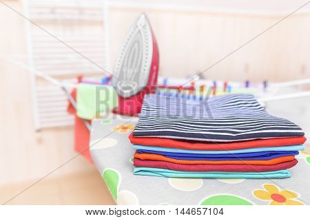 Ironed clothes on an ironing board. Close-up.