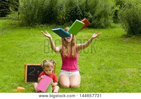 Mom and daughter are preparing for school and having fun outdoors