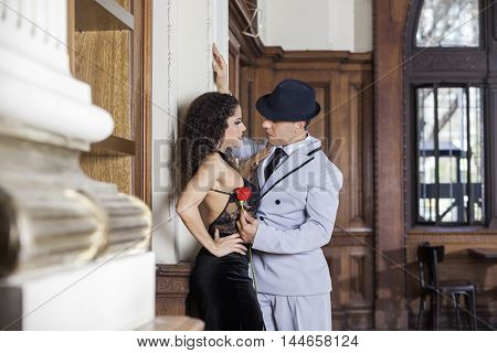 Tango Dancer Holding Rose While Looking At Sensuous Partner