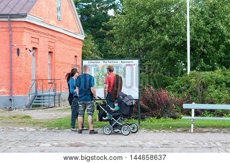 LAPPEENRANTA, FINLAND - AUGUST 8, 2016: People look at the map with territory of last Fortress on Fiinnish, English and Russian languages