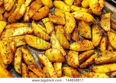 Potato food . Baked potatoes with spices and salt baking sheet. Top view