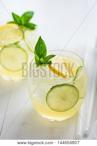 Sparkling ginger lemonade in a glass with mint