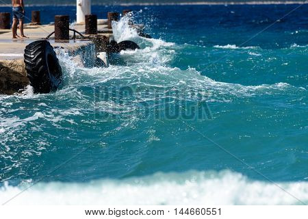 Strong Winds And Waves Are Hitting A Pier In Harbor. Port In Silba